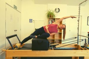 Marta performing mermaid on the reformer at Central Lakes Physio