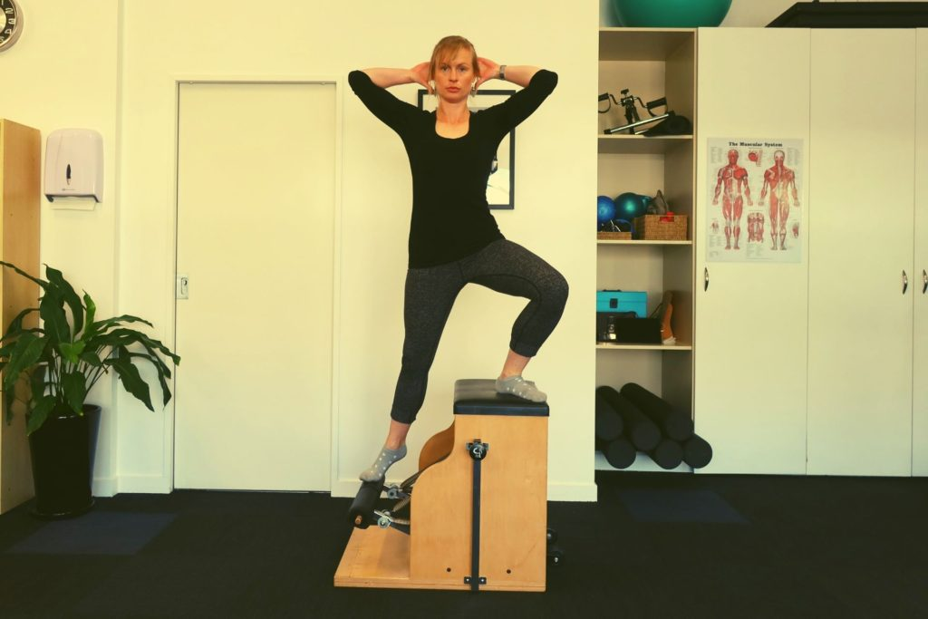 Vicky doing side lunge on Pilates Wunda Chair at Central Lakes Physio Wanaka